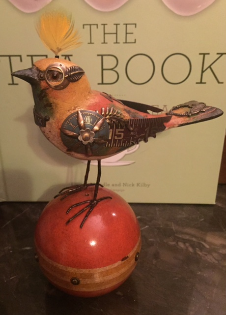 Bird on Orange Ball by Mullanium