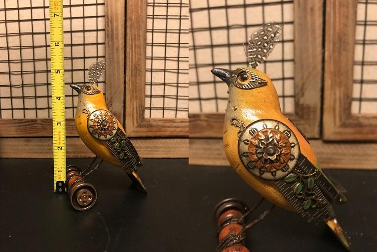 Yellow Bird on Wheels by Mullanium